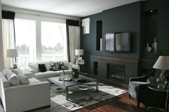 wandfarben ideen schwarze akzentwand weiße sofas orchidee lange ...