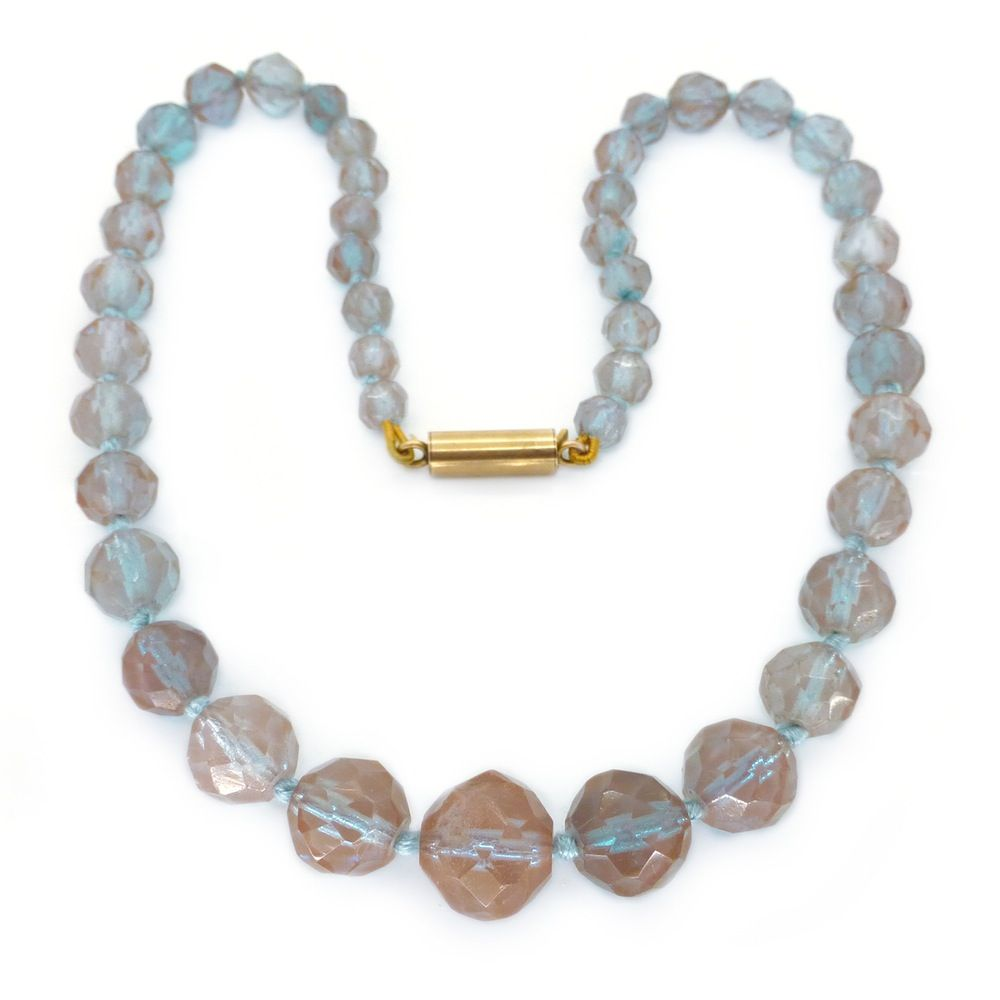 Description An exceptional early saphiret glass necklace. The necklace features beautiful faceted beads with a wonderful blue tint to them. The...