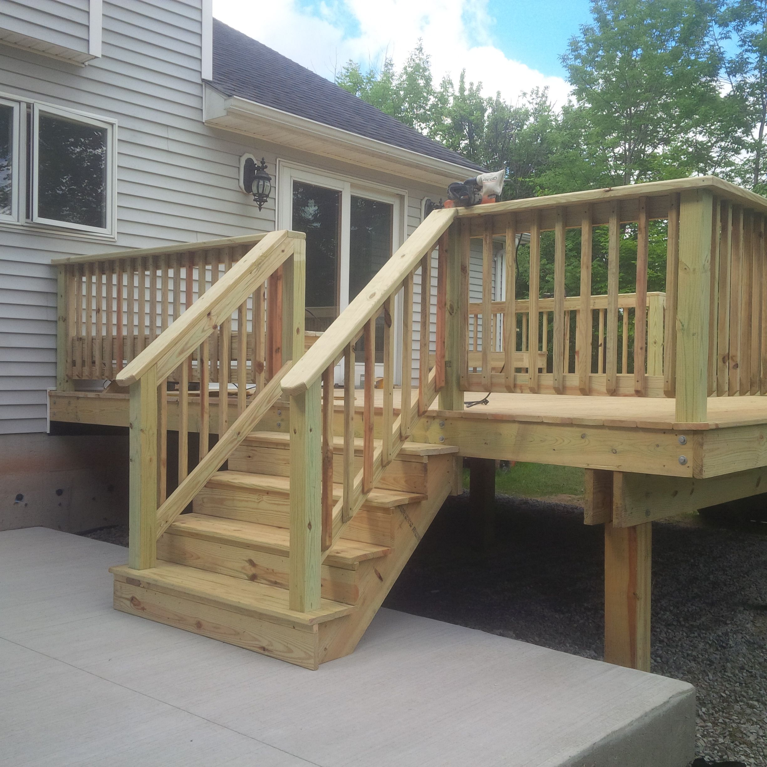Deck Railing Ideas: Pressure Treated Yard Deck And Concrete Patio