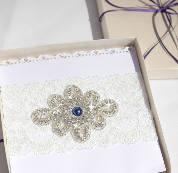 Check out this item in my Etsy shop https://www.etsy.com/uk/listing/254813279/boxed-vintage-ivory-wedding-garter-for