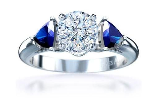 I like the diamond and sapphire rings like this one, possibly with a different setting.