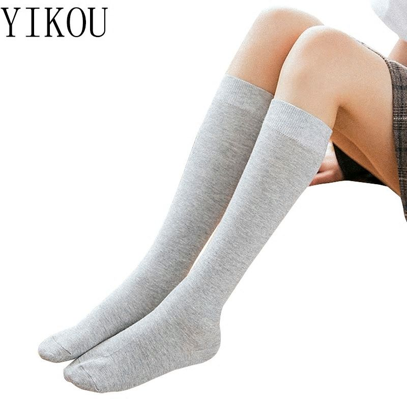 47c95536fec YIKOU Female autumn and winter solid color Japanese piles of stockings  women s fashion but knee stockings girls cotton stockings