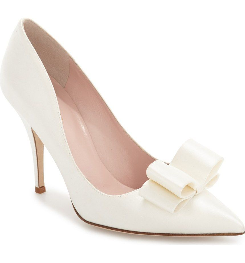 Swooning over these pointy-toe pumps by Kate Spade with a modern bow that will add a sophisticated and chic touch to the wedding day.