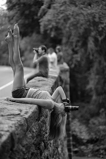 I'd be terrified to do this...but her legs are lovely and it makes for an awesome picture!
