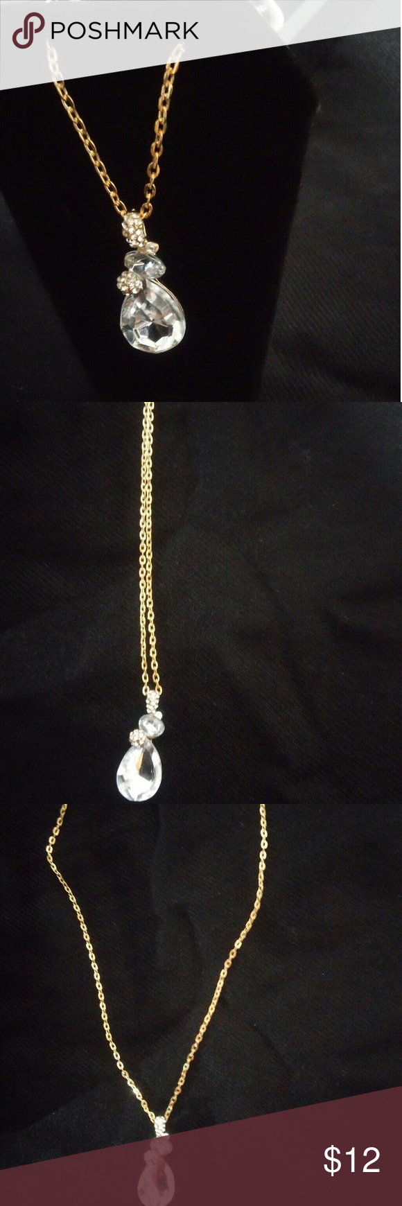 Beautiful large diamond necklace surrounded by smaller diamonds