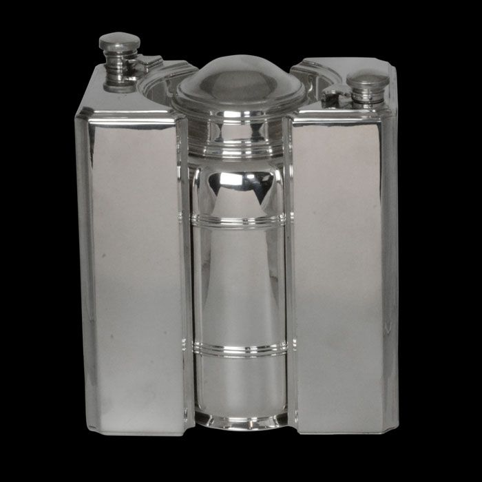 Art Deco travelling silver cocktail set. Comprising of two spirit flasks, flanking central covered cocktail shaker, with dual integral strainer and juicer and 6 silver gilt shot cups for serving. In original fitted leather case..