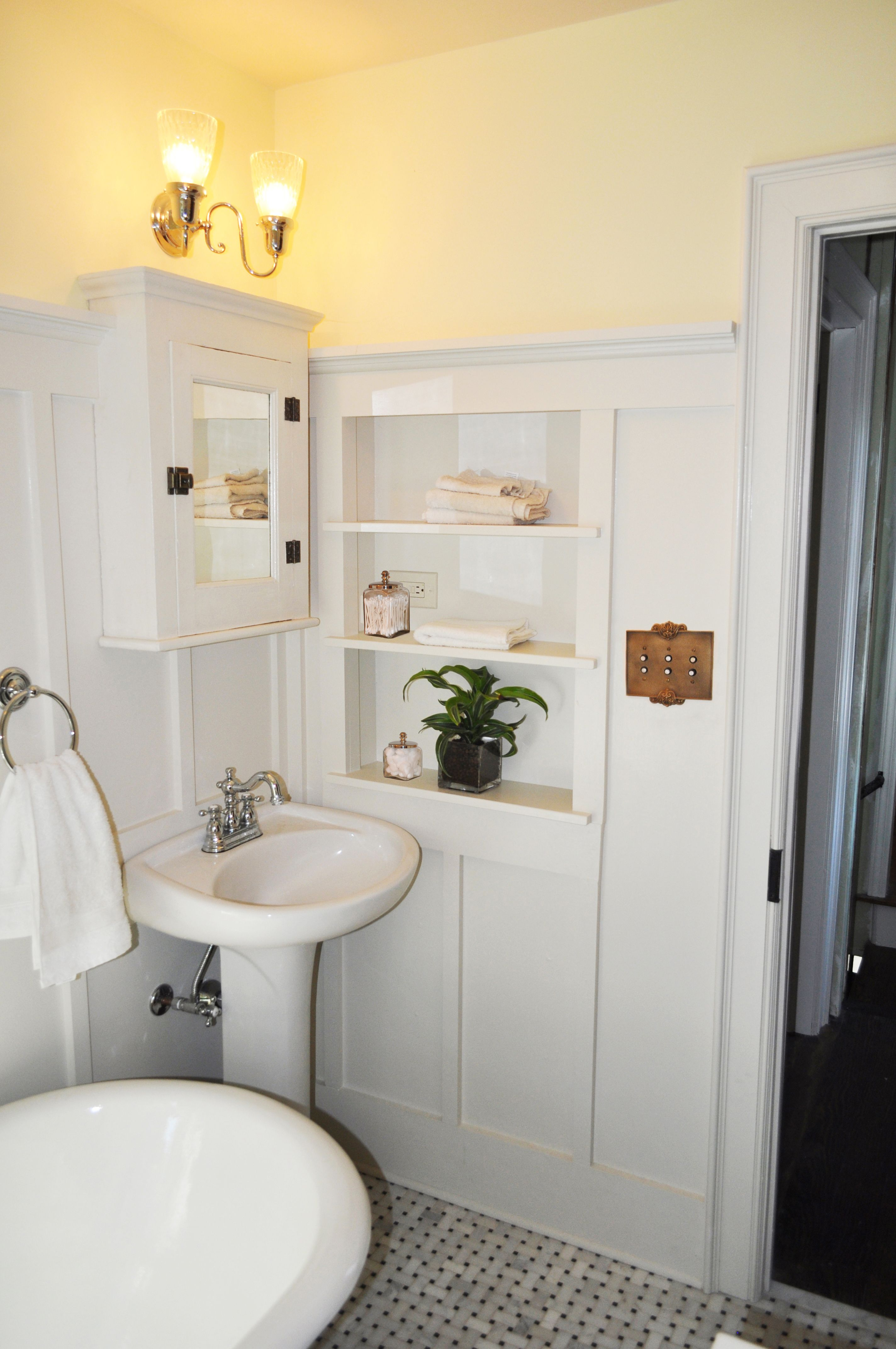 The small shelf alcove generates extra storage space and becomes an ...