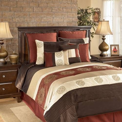 A Bold Striped Bedding Collection In Hues Of Chocolate Brown Rust