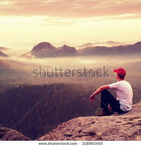 Adult sportsman in white shirt, dark trousers and red cap. Man sit on sharp…