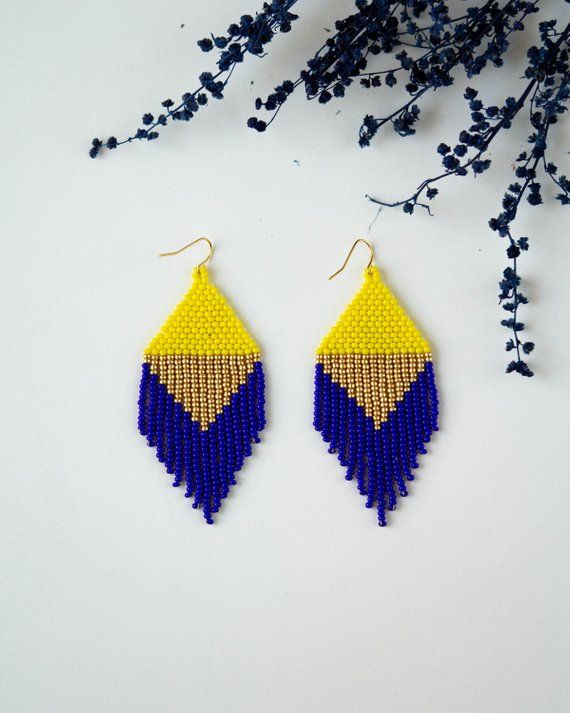 Blue yellow earrings  Beaded jewelry  Unique gift for her  Geometric earrings  Seed bead earrings  Autumn earrings  Fringe earrings is part of Beaded jewelry patterns, Bead work, Loom beading, Seed bead earrings, Beaded earrings patterns, Beaded earrings - items section id 23376282 See a style you like but want different colors  Have a design in mind  Let's make it happen! Send me a message  and we can talk to create a perfect oneofakind piece  Note that pricing is subject to negotiation based on desired style! All earrings and jewelry are original, designed and made by travel jewell   Pattern and design are not for copy, publishing or distribution   PM me for any copyright and legal inquiries