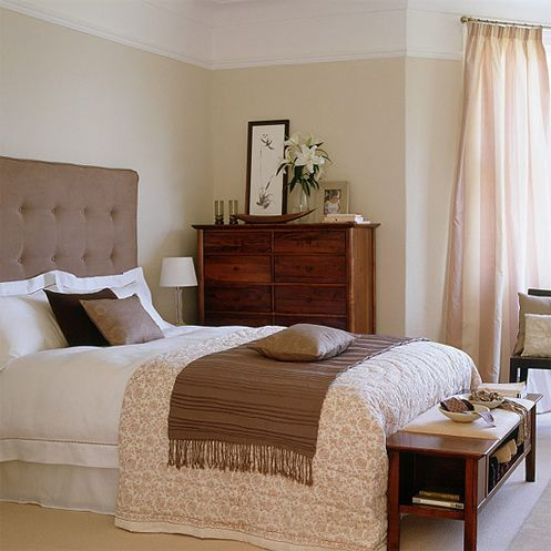 A Lovely Calm And Sophisticated Bedroom With Cream Walls And Carpets Accented By Cold Brown