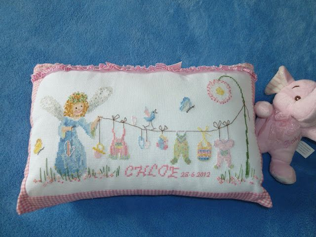 What an adorable sampler stitched by June for her new great-granddaughter!