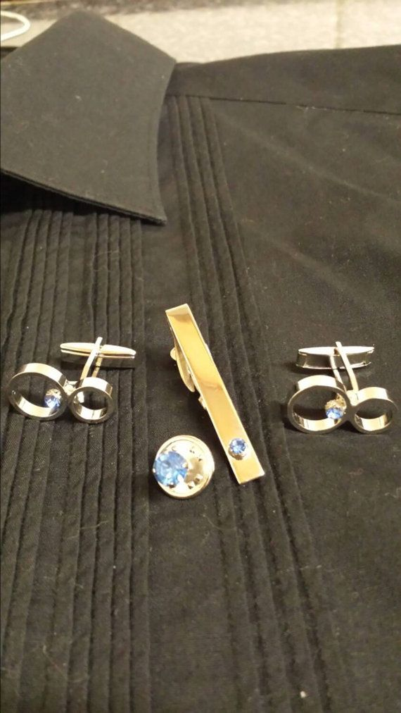 Check out this item in my Etsy shop https://www.etsy.com/listing/210335263/vintage-cuff-links-tie-bar-and-tie-tack