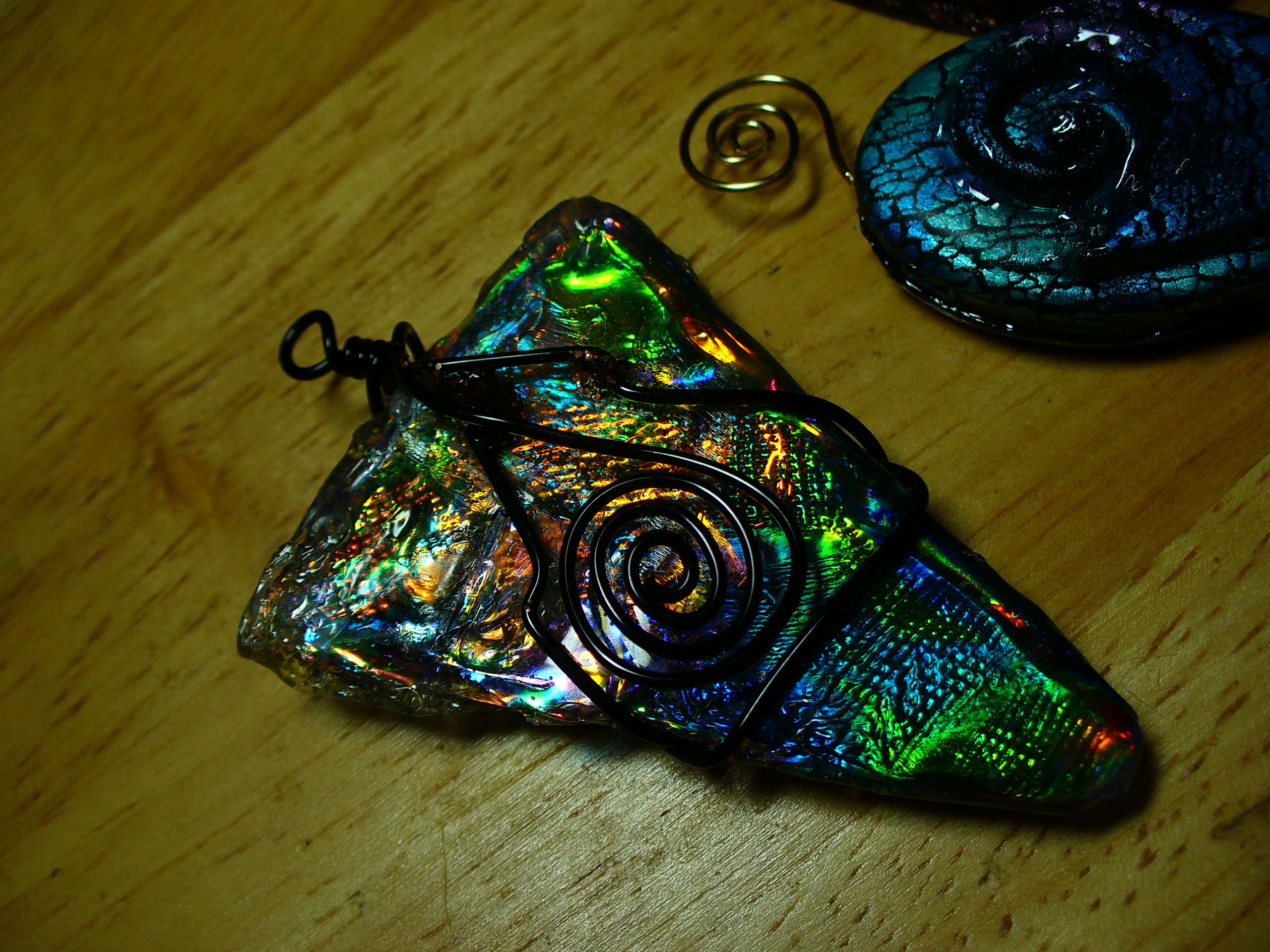 This piece was made similarly to the heart shaped box in my previous post. The base of it is not paper, though...it is a CD! Then covered with film and UTEE and wire wrapped. It has held up VERY well. The picture does not do the colors justice...