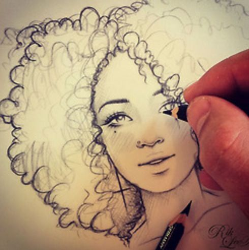Curly haired girl drawing: