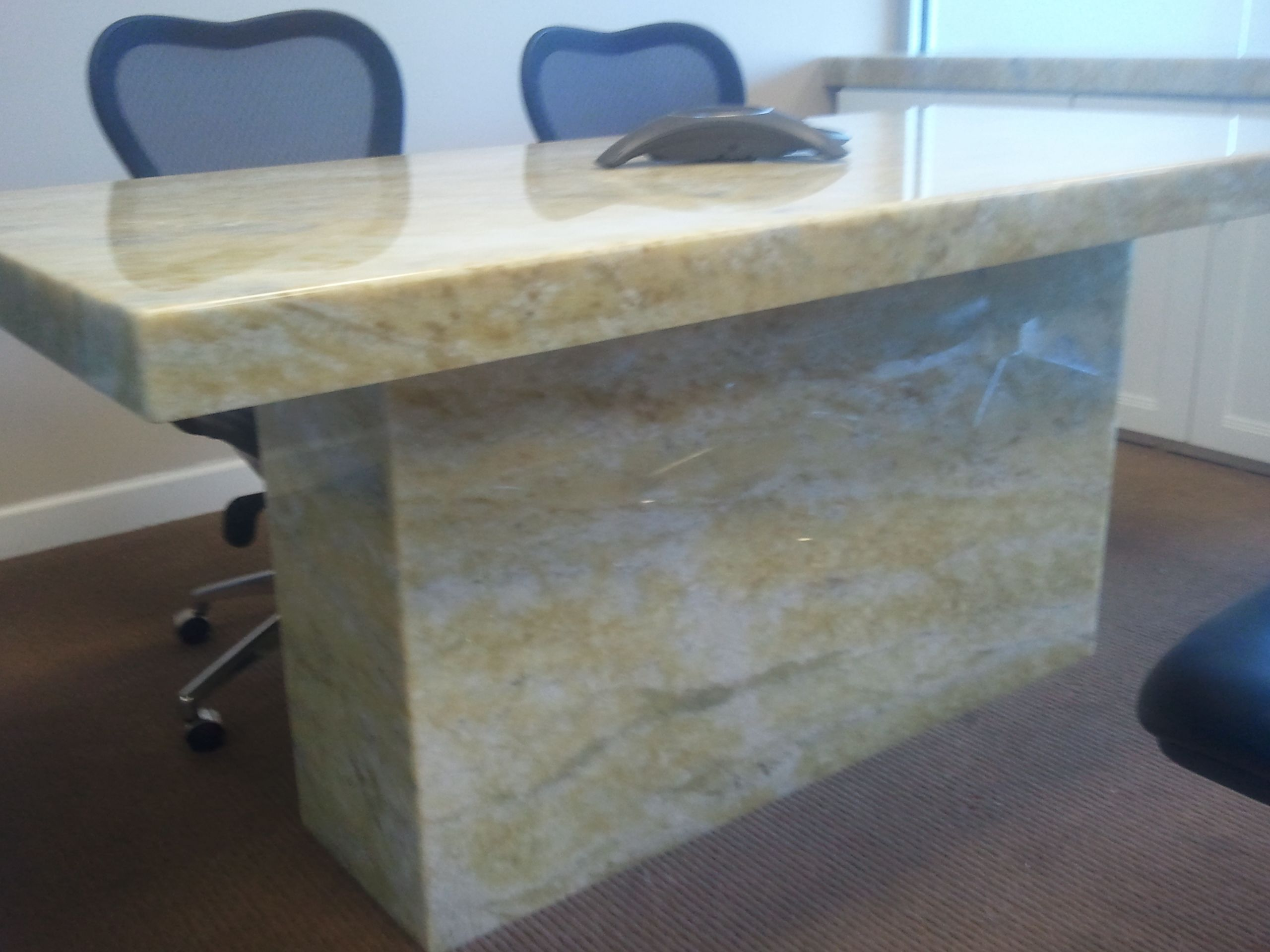Custom fabricated yellow onyx backlit conference table for new