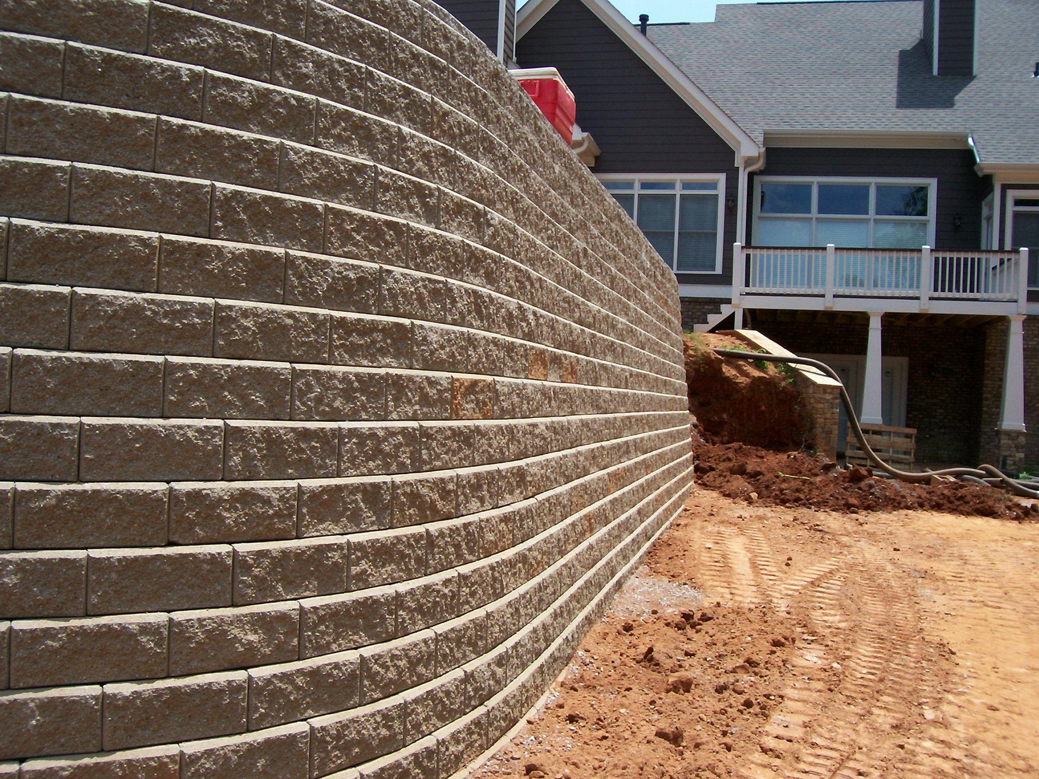 15'+ high modular retaining wall.  Buff Modular Blocks, Summit Subdivision, Dawsonville, GA.  Retaining wall for a pool install.