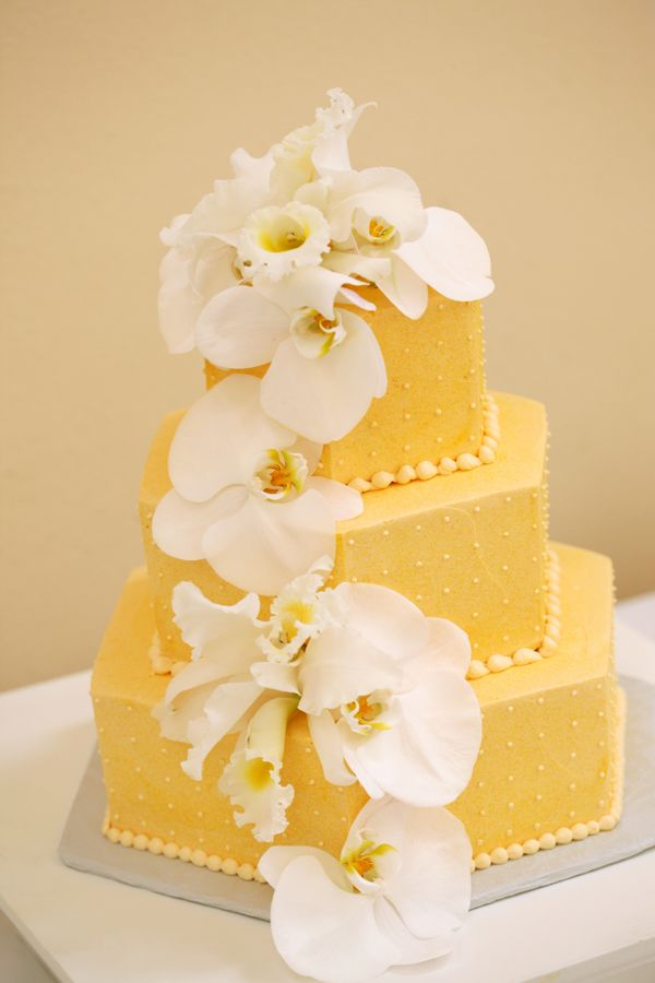 WeddingCakes - White Orchids on the golden Wedding Cake form a ...