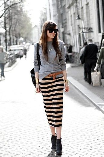 """This look is comfy, cool, and absolutely spring-appropriate. Extra points for the look's interesting small touches, like the knotted belt, and the skirt's cool length that shows a just a bit of leg (and showcases a pair of ankle boots.)"""""""