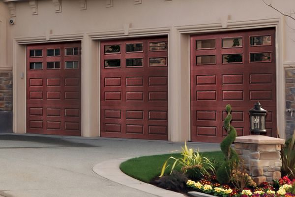 Most 16 By 7 Foot Fiberglass Doors Cost About 1 800 Installed While Hardwood Doors Start Around 2 500 T Wood Garage Doors Faux Wood Garage Door Garage Doors