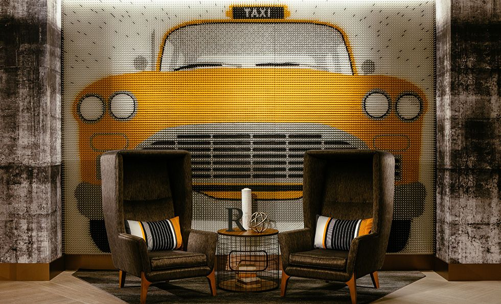 A yellow taxi on a wall next to the renaissance chicago downtowns reception is made from