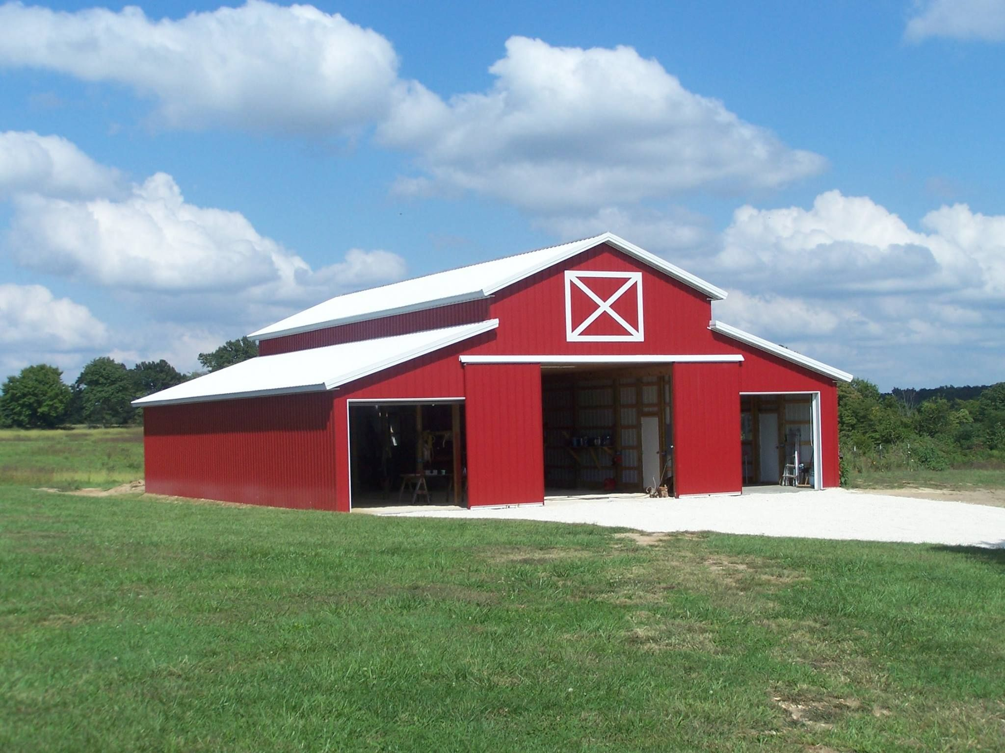 Red metal sided barn metal buildings houses and tin for Metal barn images