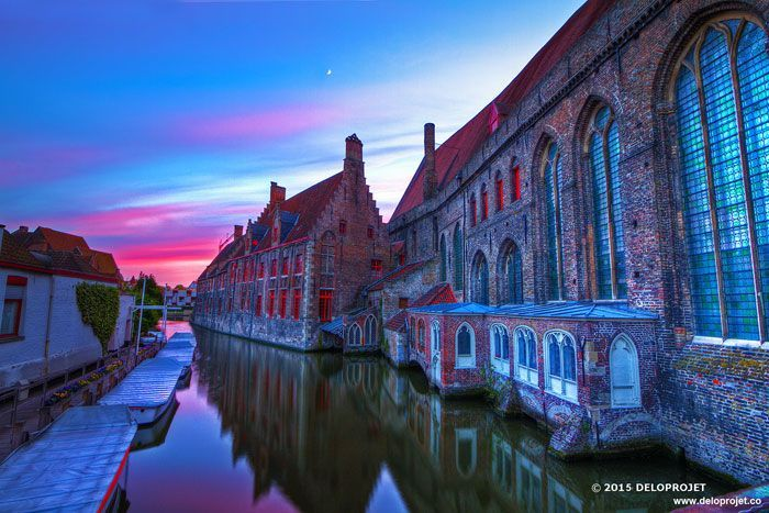 "Walk under the sunset, in the streets of Bruges, Belgium. The one that the city is nicknamed the ""Venice of the North"" has the center is surrounded by a network of canals."