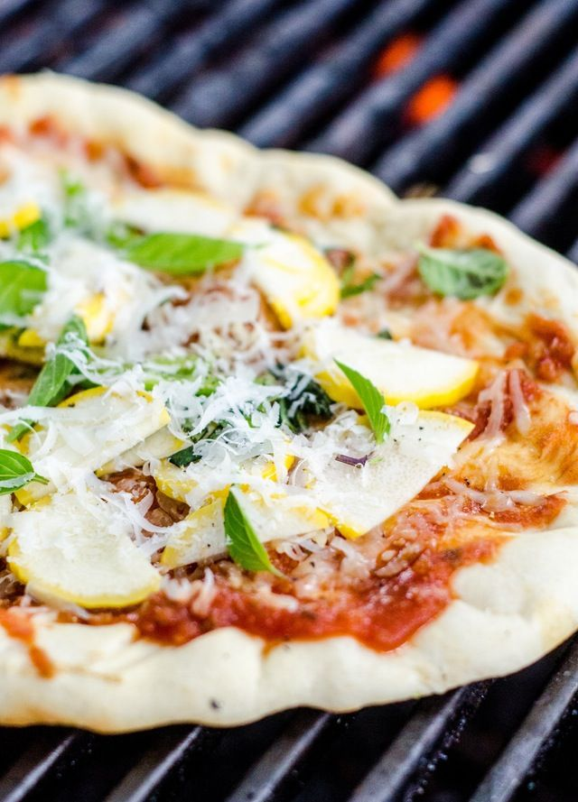 Grilled pizza is a summertime meal that has everything going for it. Whip up the dough, top with your favorite cheese and goodies, and grill while hanging out on the back deck with friends, wine glasses in hand. It's easy, make-ahead, and elegant in all the right ways, and it doesn't heat up your kitchen. Bonus. But to make a great pizza, you need a great dough. Here's our favorite dough recipe for grilled pizza — and I guarantee you have time to make it. Whether you're making pizza an hour…