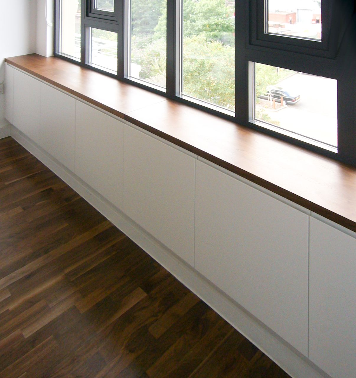 Under window storage/seating   Booth seating in kitchen, Built in ...