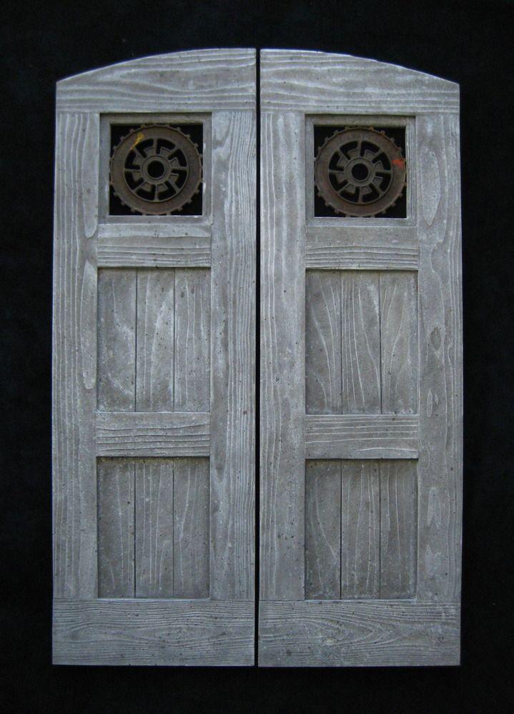 Custom saloon doors featuring antique industrial iron gears from  IronAnarchy.com - Custom Saloon Doors Featuring Antique Industrial Iron Gears From