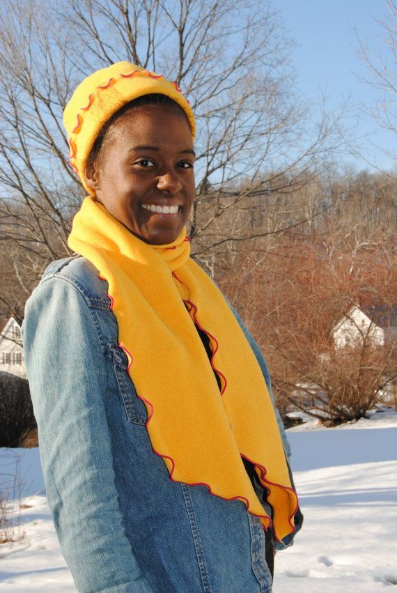 02272d7dec597 This sunshine combo includes a fleece scarf and hat. They re made with  Polartec fleece that s a bright sunny yellow with a hot pink trim. Hand-made  in ...