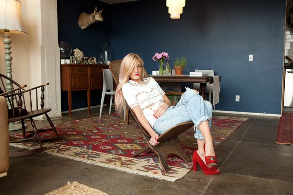 ripped vintage jeans with a laser-cut T-shirt by Yasmin Kianfar and red Opening Ceremony pumps