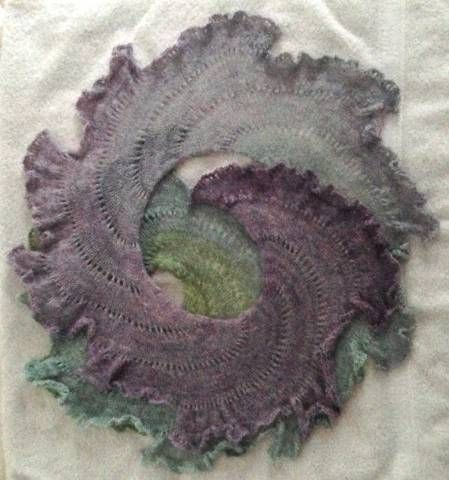 "This is my kind of ""potato chip"" scarf! Lichen ruffles in soft, spiraling semi-circles that require only basic knitting skills – knit, purl, yarn over and bind off. I have fussed…"