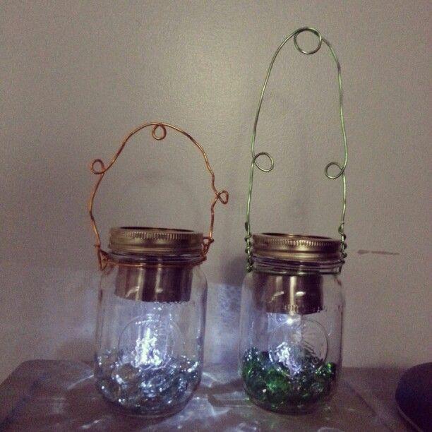 Diy Solar Mason Jar Lanterns Small Solar Powered Light Inside A Mason Jar With Accent Stones And Wire Solar Mason Jars Mason Jar Lanterns Solar Lights Diy