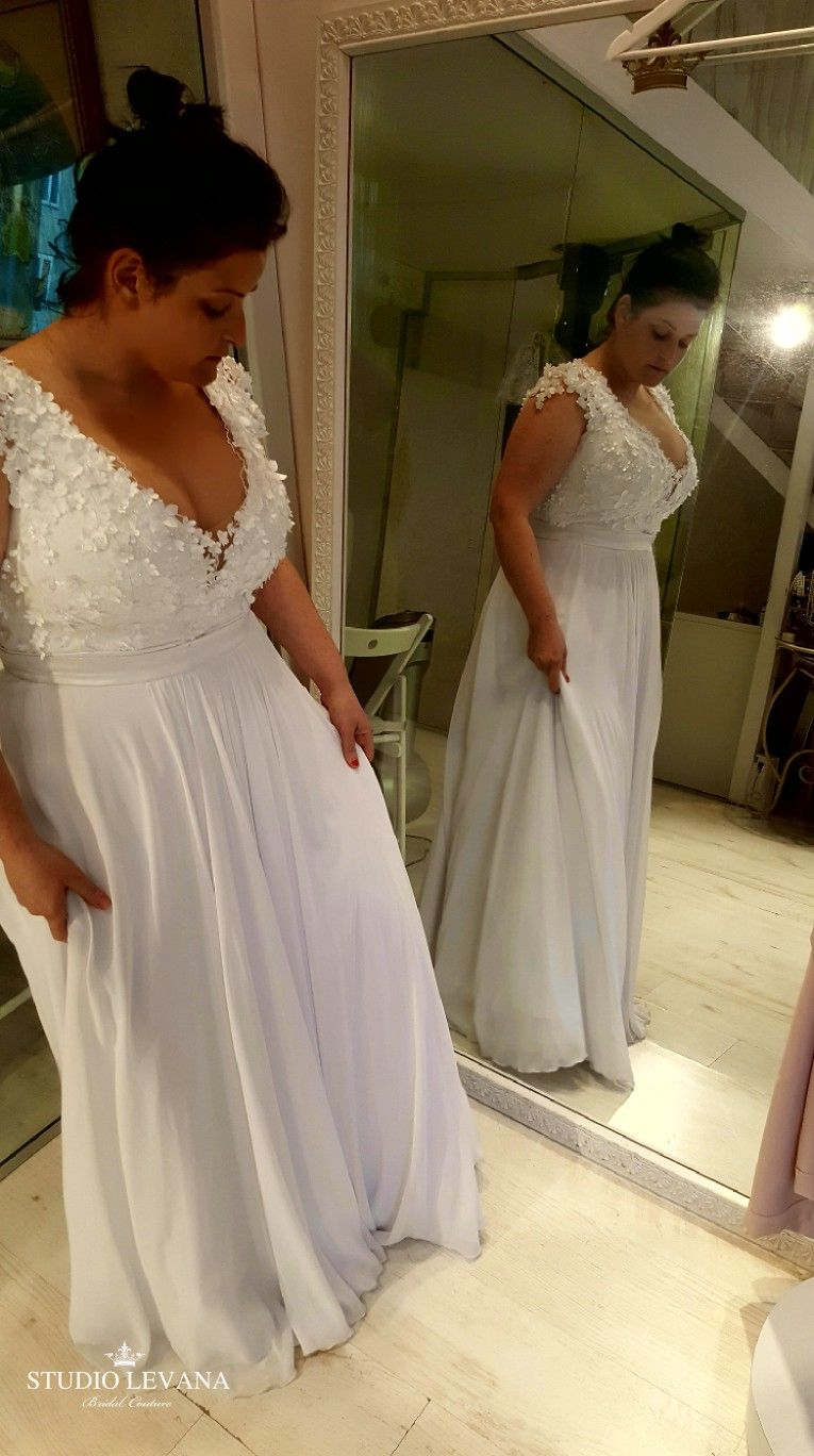 Real curvy bride in a romantic boho plus size wedding gown from