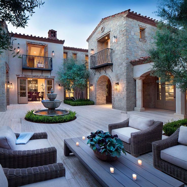 Photo of Northern Italian style villa surrounded by an inviting desert oasis