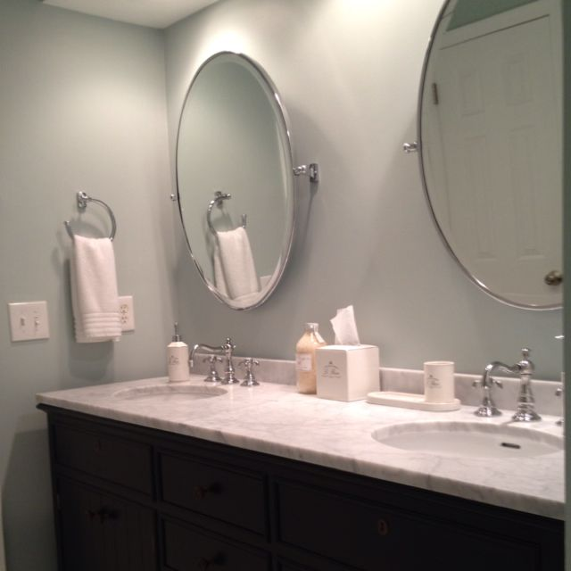 Bathroom Fixtures Restoration Hardware double vanity, faucets, oval pivot mirrors and bath accessories