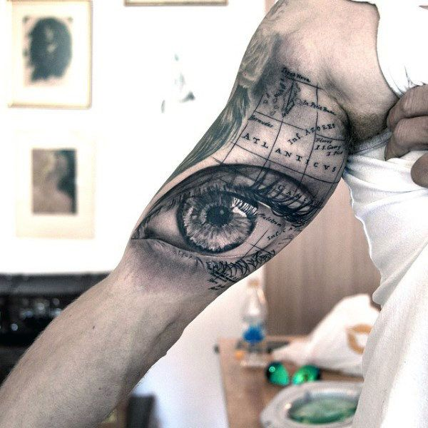 50 world map tattoo designs for men adventure the globe eye and world map tattoo for males gumiabroncs Choice Image