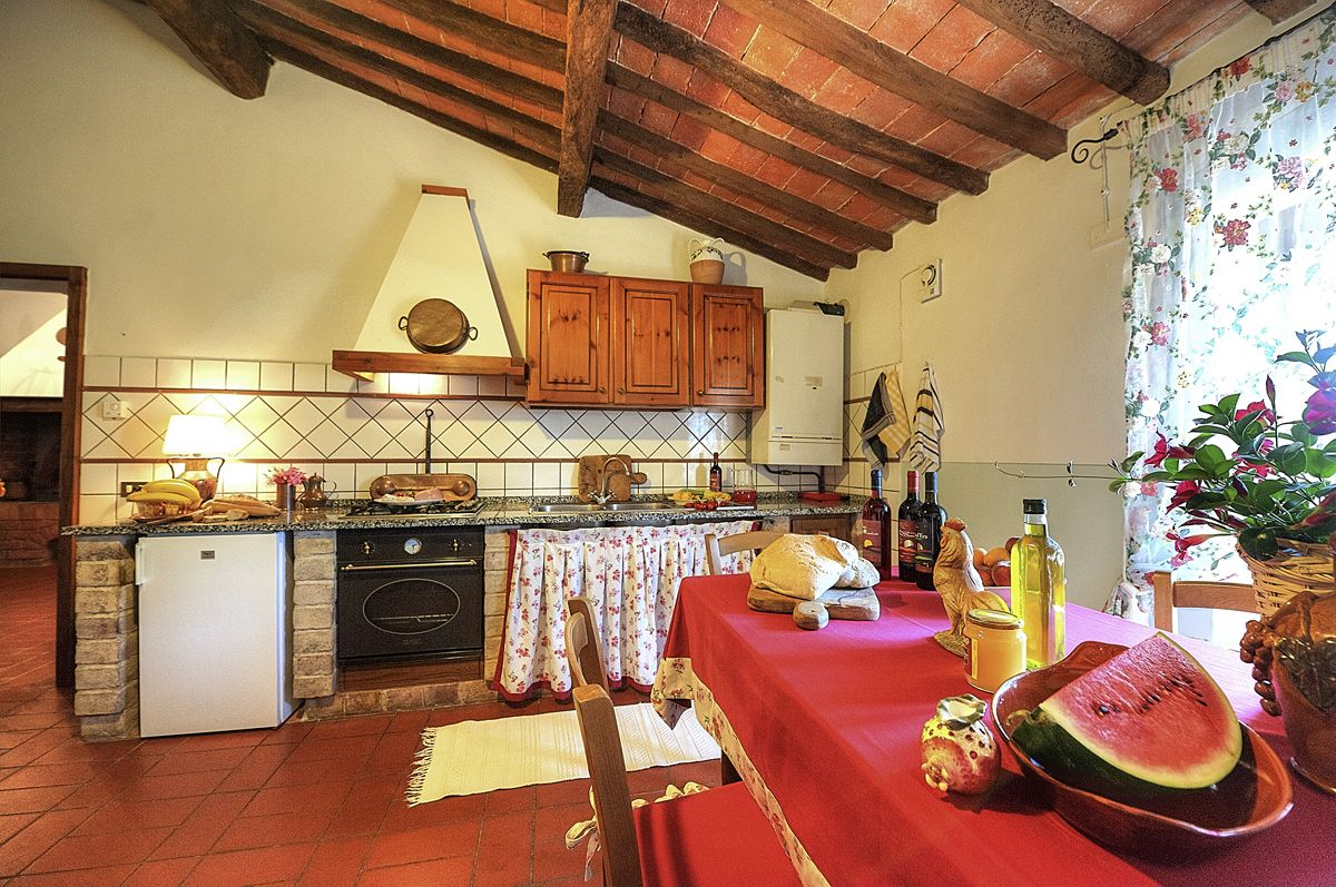 The interior and exterior of the apartment Lilla in the Canale Farm, Montelopio, Tuscany.