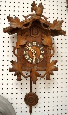 GERMAN BLACK FOREST CARVED CUCKOO CLOCK. HEIGHT 14""