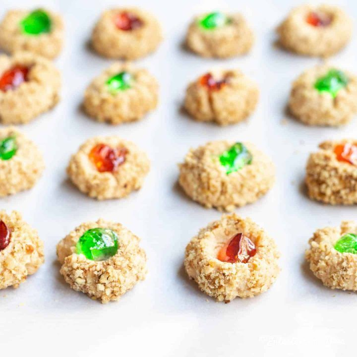 I love these shortbread thimble cookies rolled in nuts and filled with jam or jelly. The green and red looks very pretty on a plate making them a perfect Christmas party dessert recipe. #entertainingdiva #Christmascookies #cookierecipe #shortbread #christmas #christmastreats