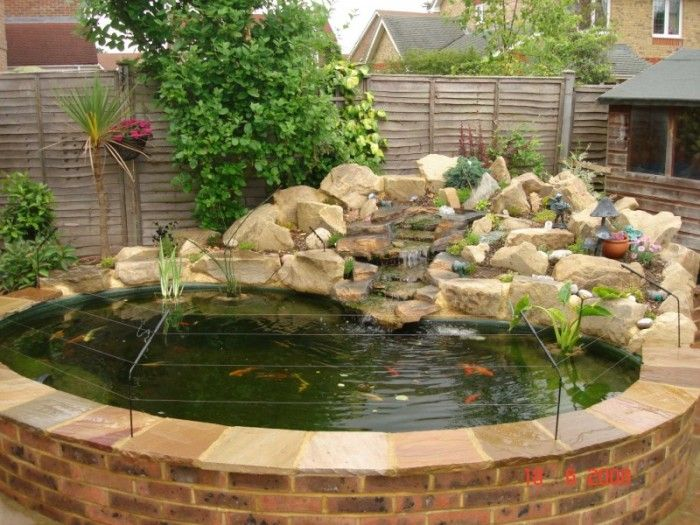Stone wall raised pond small ideas google search for Raised koi pond ideas