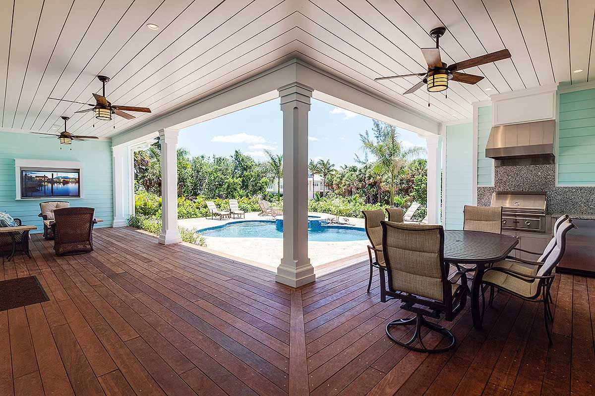 View of the pool from the covered lanai architectural designs net zero ready house plan 33161zr built in florida with almost 2900 sq ft of living
