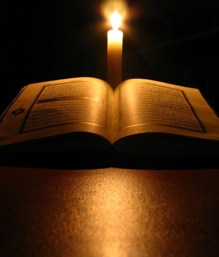 Importance Of Quran In Muslims Life Quran Candle Photography Dark Holy Quran Recitation