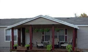 How To Build A Gable Roof Over A Deck Hunker Building A Deck Patio Roof Pergola Plans