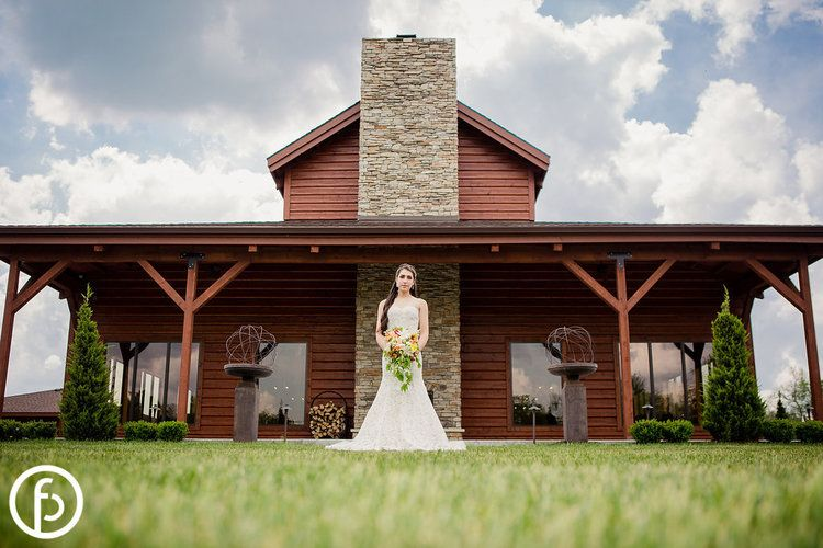 Buffalo Lodge Wedding. Kingsville, MO. Floral by Andrea K. Grist Floral Art. Image by Freeland Photography. Kansas City Wedding Planner Madison Sanders Events. Makeup and Hair by B-Envied. gown by Altar Bridal.