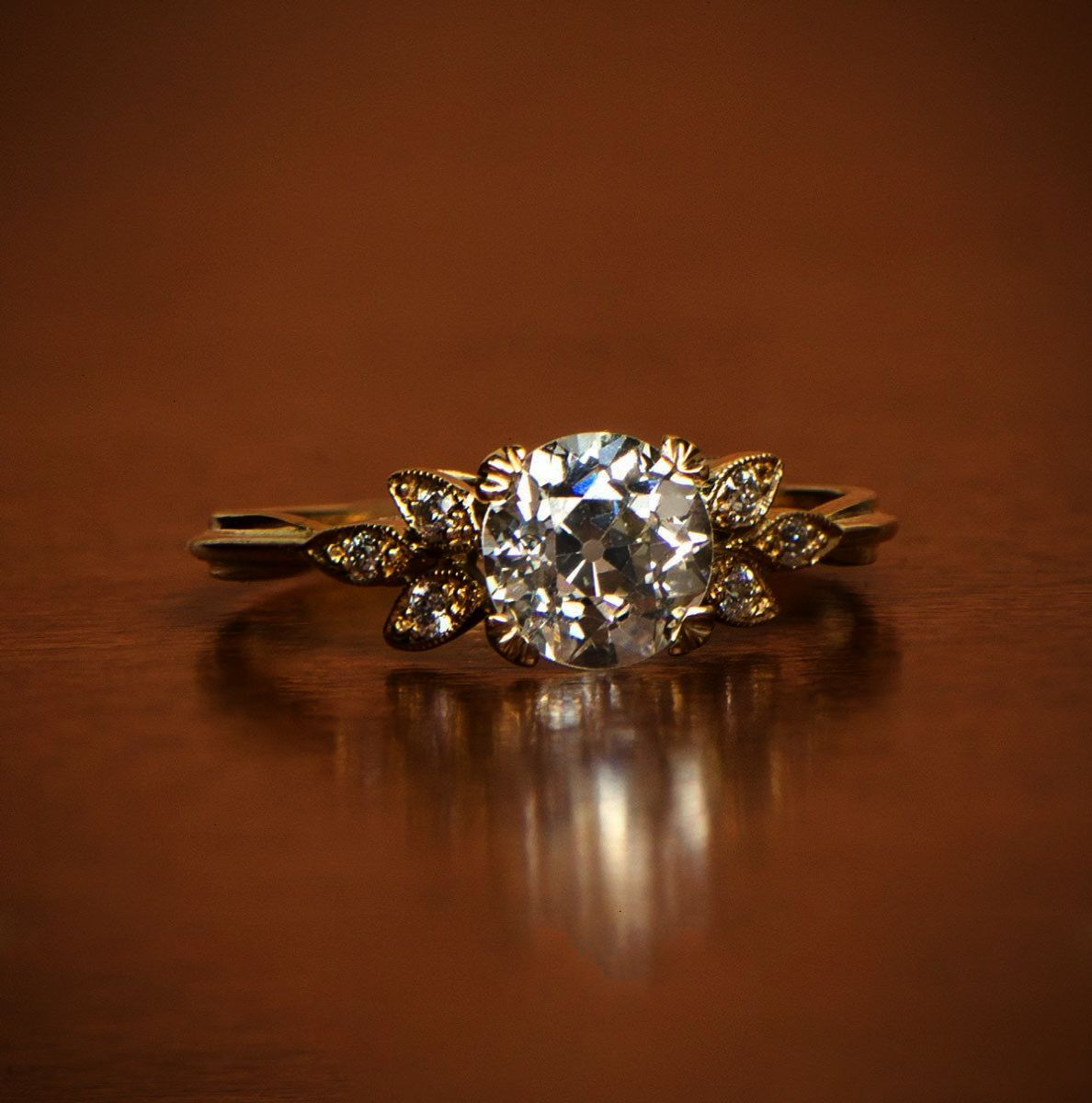 A beautiful vintage style engagement ring adorned in k gold and