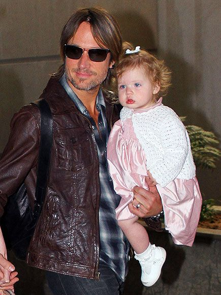 Keith Urban and his daughter Faith. She looks just like her daddy so cute!!