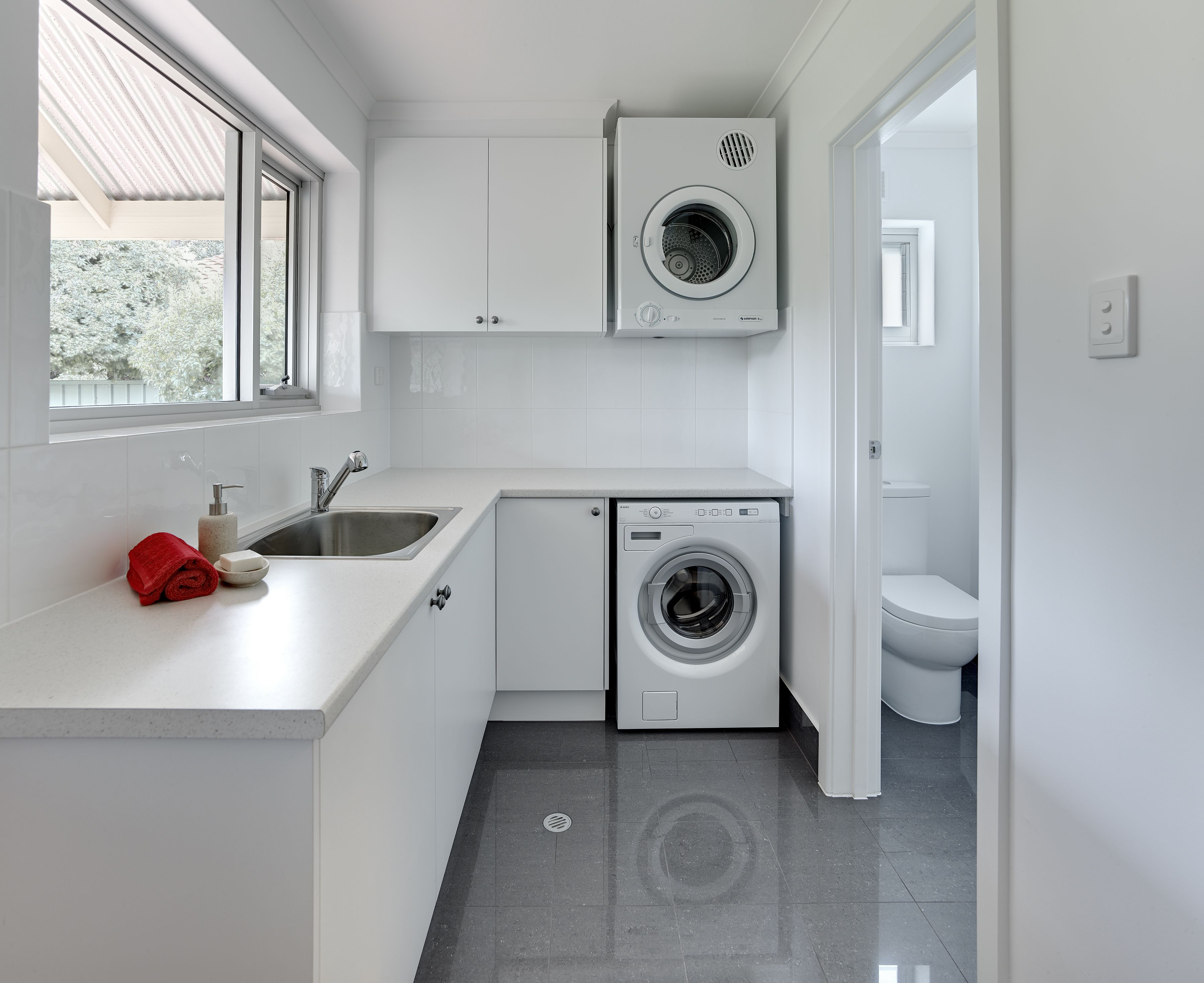 Neutral, simple Laundry design with Laminex benchtops #brilliantsa ...