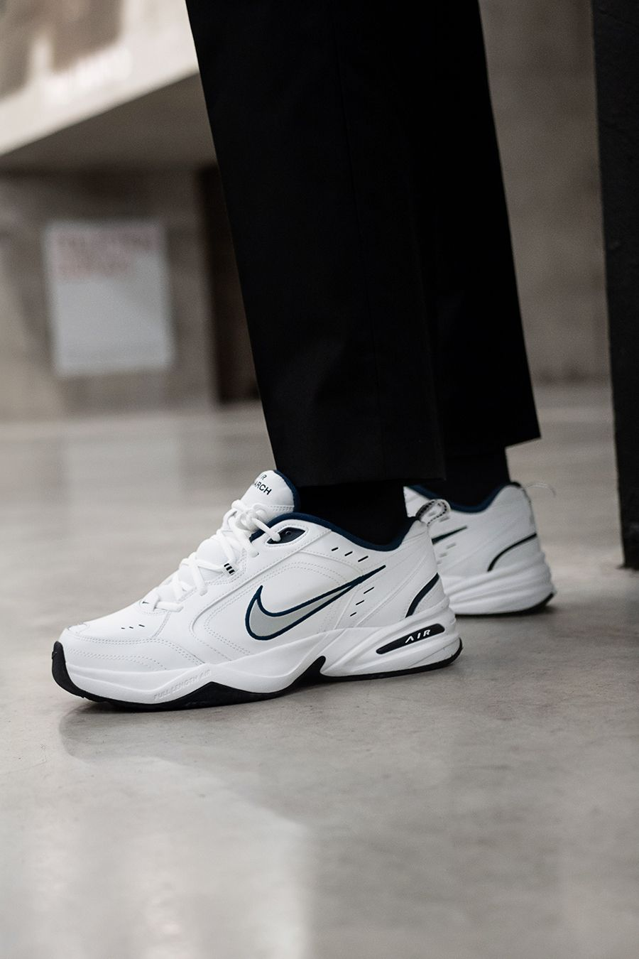 White Nike Air Monarch trainers  9f4108a12